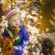 Little Girl in the Autumn Park Laughs and Tears the Leaves of the Tree - VideoHive Item for Sale