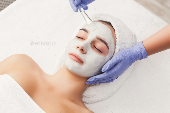 Woman gets face mask by beautician at spa - Stock Photo - Images