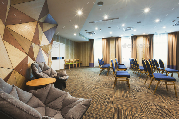 Modern hotel lobby with abstract wooden wall Stock Photo by