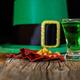Patrick day green drink, leprechaun hat and gold prills
