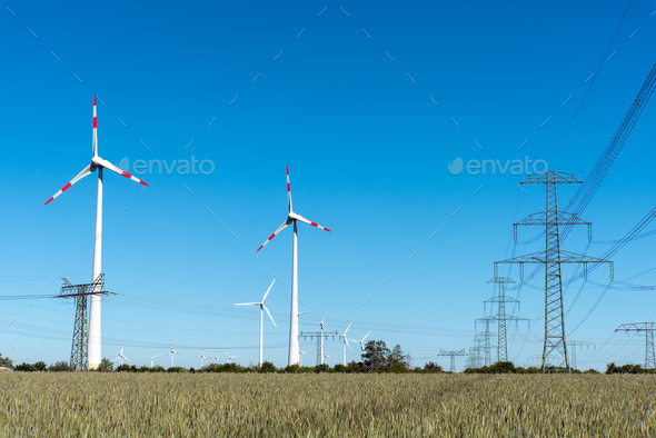 Windwheels and power transmission lines in Germany - Stock Photo - Images