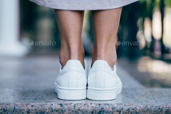 town and legs of woman - Stock Photo - Images