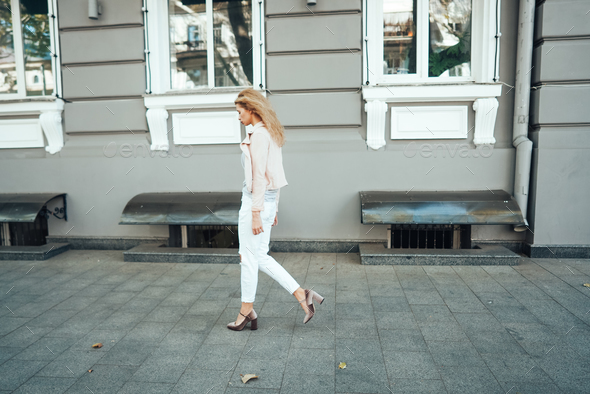 Girl is posing on the city street - Stock Photo - Images
