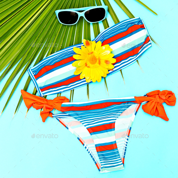 Stylish beach outfit for girl Swimsuit and accessories - Stock Photo - Images