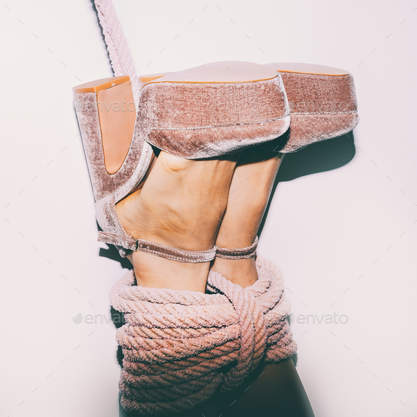 Sexy heel legs tied with a rope. Time for Games - Stock Photo - Images
