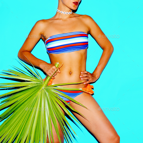Model beach fashion trend. Striped swimsuit. Minimal style - Stock Photo - Images