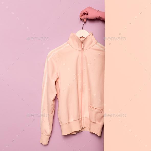 Stylish sportswear. Minimal fashion. Pink jacket on a hanger. Wa - Stock Photo - Images