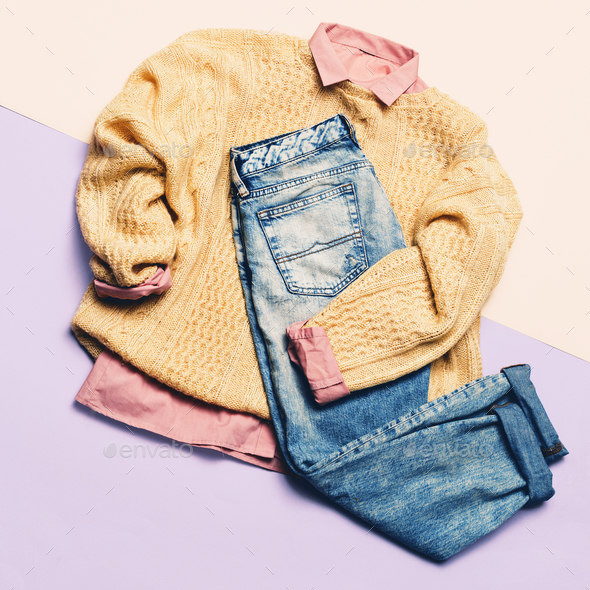 Ladies Fashion Clothes. Pink shirt, sweater and jeans. Hipster. - Stock Photo - Images