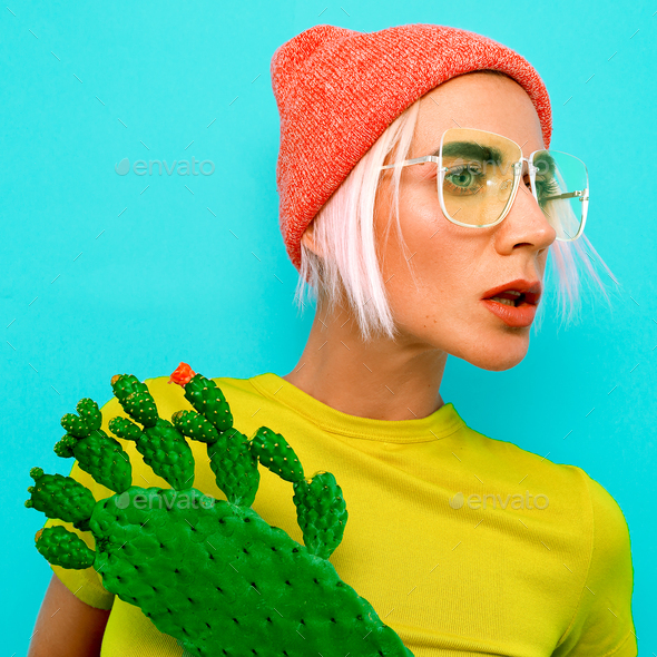Pretty Blonde Model in stylish accessories. Beanie and glasses. - Stock Photo - Images