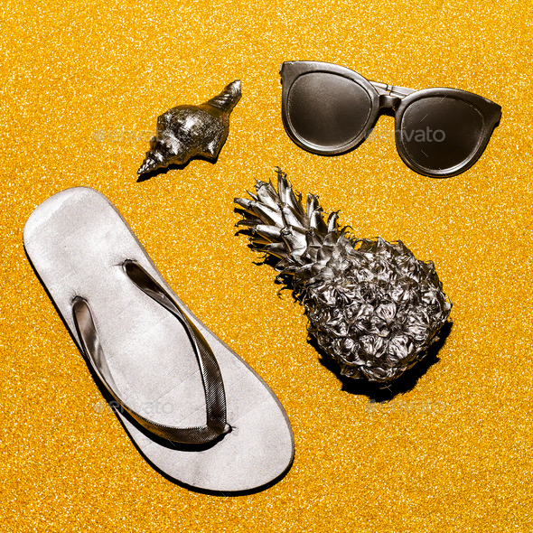 Silver beach set on a gold background. Vacation outfit - Stock Photo - Images