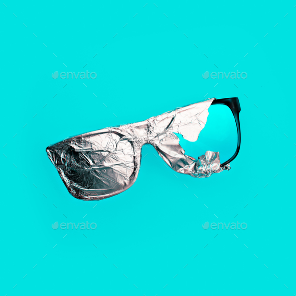 Sunglasses in the aluminum foil. Stillife art - Stock Photo - Images