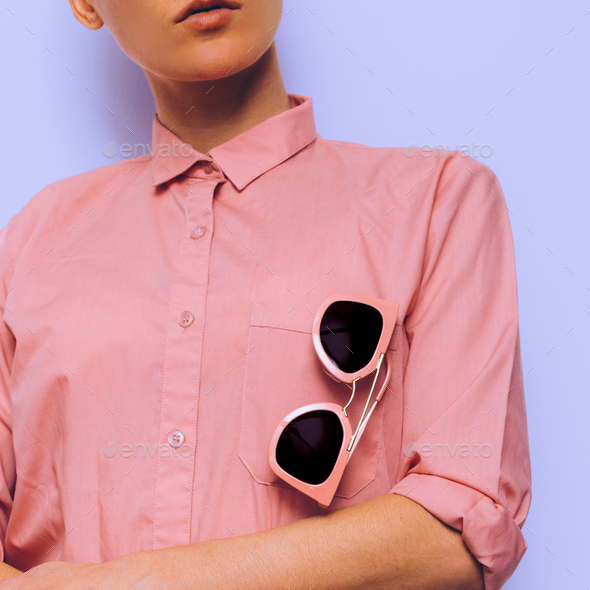 Girl in a pink shirt and pink sunglasses. Stylish clothes - Stock Photo - Images