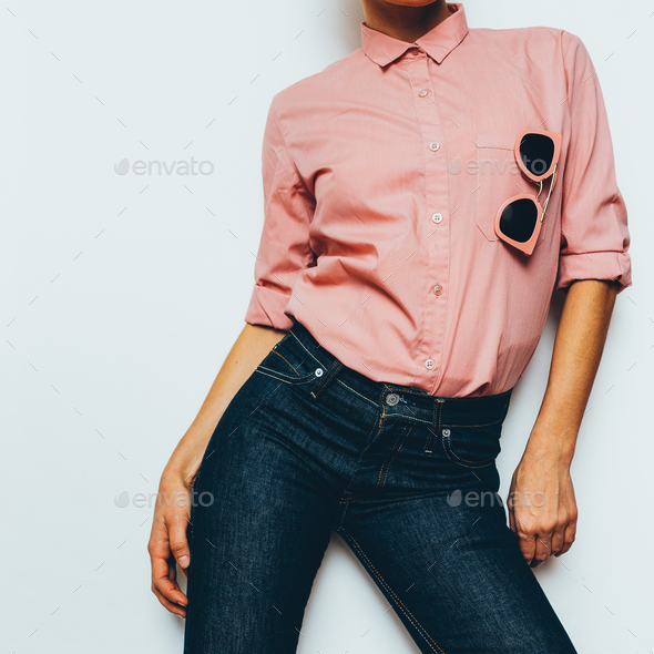 Girl in a pink shirt and classic jeans Stylish Clothing - Stock Photo - Images
