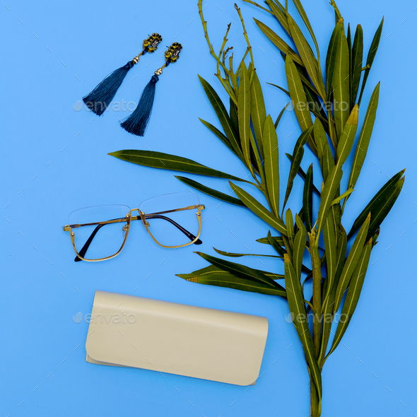 Glasses and Earrings. Stylish accessories for women. Flat lay mi - Stock Photo - Images