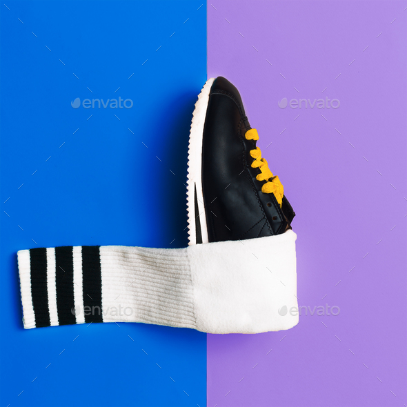 Minimal fashion creative art. Stylish sneakers and socks. - Stock Photo - Images