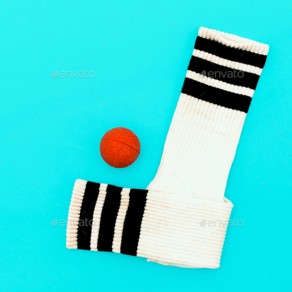 Soccer socks and ball. Play. Minimal art. - Stock Photo - Images