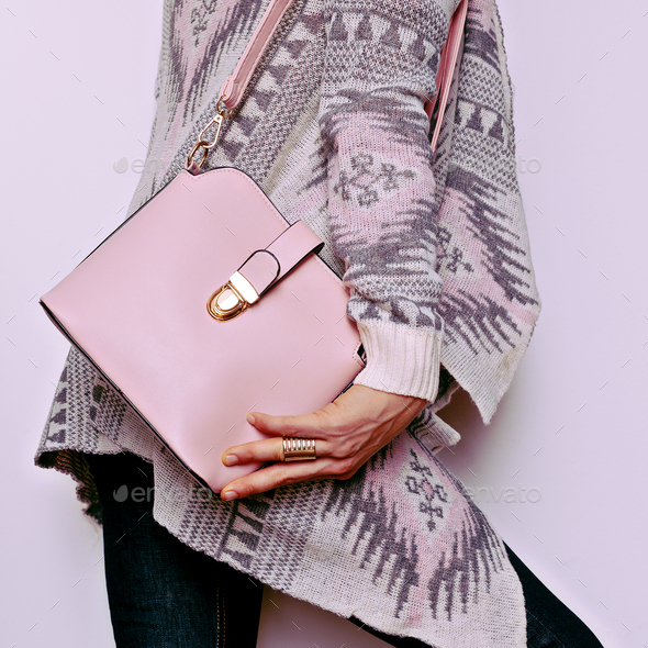 Lady in sweater ornaments and fashion accessories. Bag and styli - Stock Photo - Images