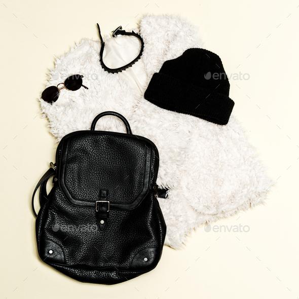 Black fashion set. Fur coat and black accessories. Bag, sunglass - Stock Photo - Images