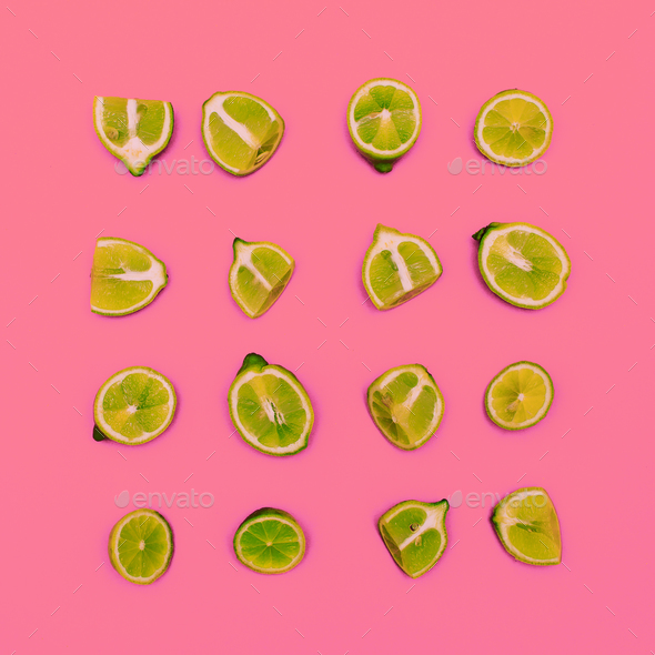 Limes on a pink background. Minimal idea food creative - Stock Photo - Images