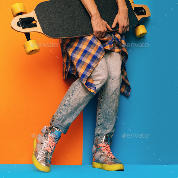 Skateboard Style fashion Girl. Minimal Design. Skateboard and de - Stock Photo - Images