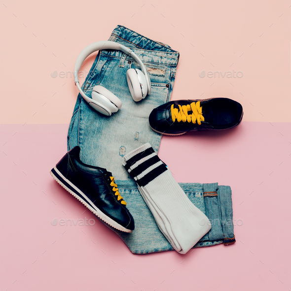 Jeans and sneakers. Knee socks. Urban Active outfit. Headphones. - Stock Photo - Images