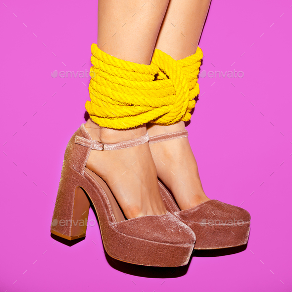 Glamorous lady heels tied with a rope. Time to play - Stock Photo - Images