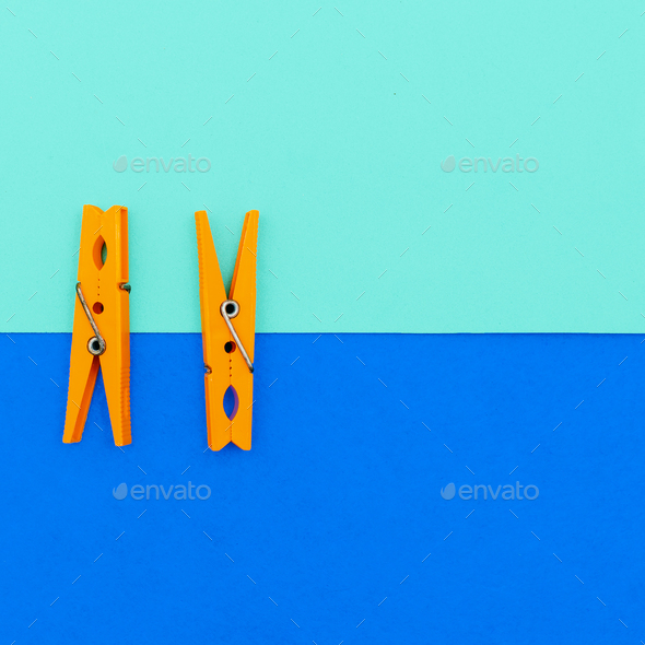 Orange clothespins.minimal art style - Stock Photo - Images