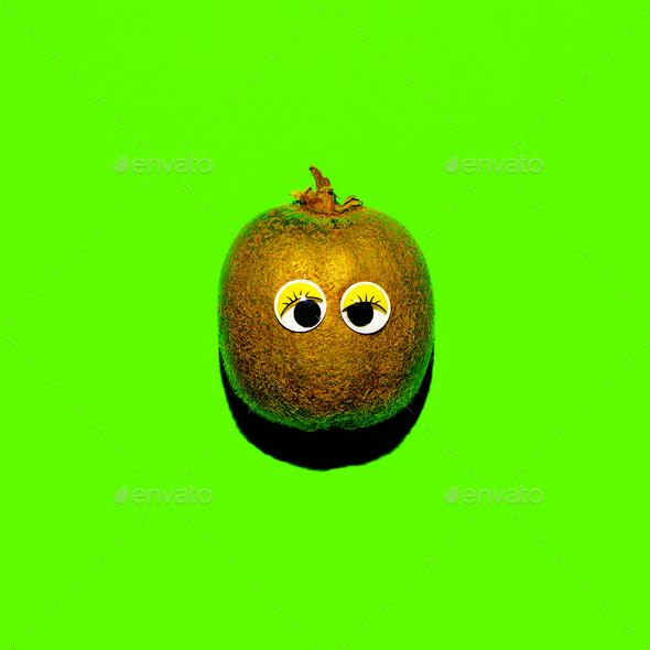 Kiwi with funny eyes Vegan minimal style - Stock Photo - Images