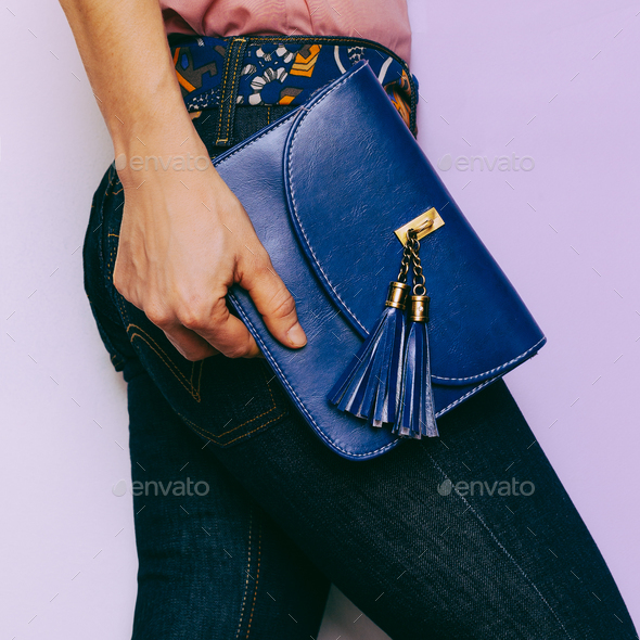 Lady in blue jeans and fashion accessories. Bag Country Style - Stock Photo - Images