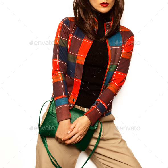 Brunette girl outfit Stylish Accessory Bag - Stock Photo - Images