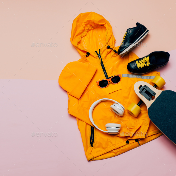 Jacket, headphones, skateboard. Urban style. Street Outfit - Stock Photo - Images
