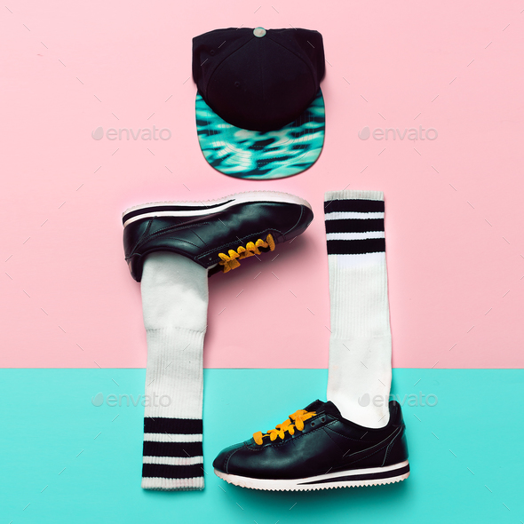 Minimal fashion creative art. Stylish sneakers and socks. Cap. S - Stock Photo - Images