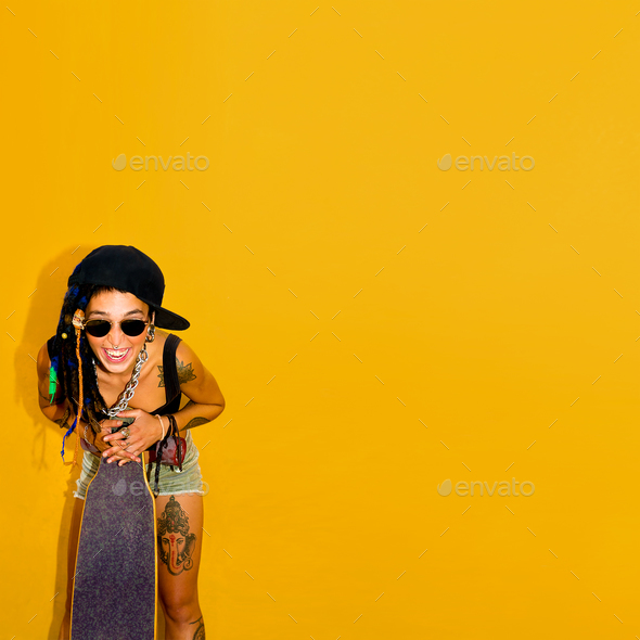 Dont  worry. Be happy. Girl with dreadlocks and tattoos. Skatebo - Stock Photo - Images