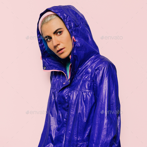 Hipster model in bright jacket hood sport style urban Outfit - Stock Photo - Images