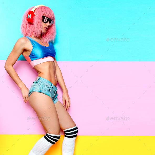 Music and fitness. Sports Slim DJ girl. Playful style. - Stock Photo - Images