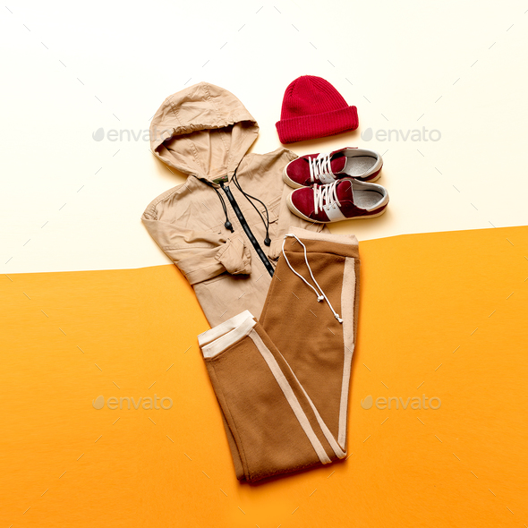 Urban Style Clothing. Skateboard fashion outfit. beige color - Stock Photo - Images