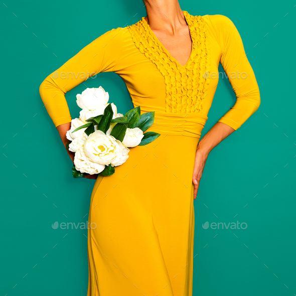 Lady in a stylish yellow vintage dress. Retro chic - Stock Photo - Images