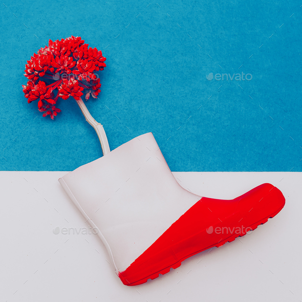 Rubber boot and flower. Minimal art - Stock Photo - Images