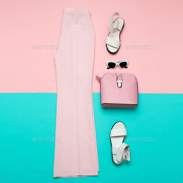 Stylish pink clothing for ladies. Fashion trousers and accessori - Stock Photo - Images