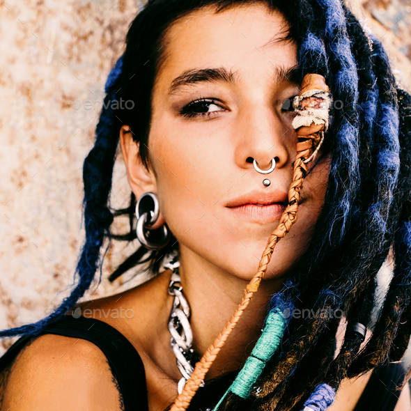 Teen spanish girl with trendy dreadlocks and piercings. Outdoor - Stock Photo - Images