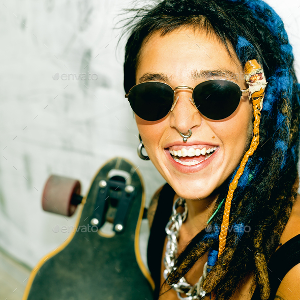 Happy Girl Skater with Dreadlocks. Street style - Stock Photo - Images