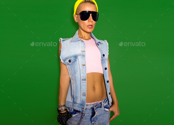 Model Tomboy style fashion beanie cap and sunglasses. Urban Jean - Stock Photo - Images