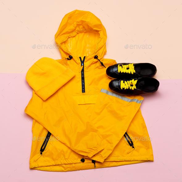 Fashionable Orange Jacket, headphones, sneakers. Urban style. St - Stock Photo - Images