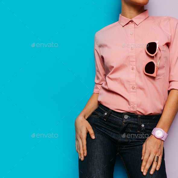 Girl in pink shirt and pink accessories. Watches and sunglasses. - Stock Photo - Images