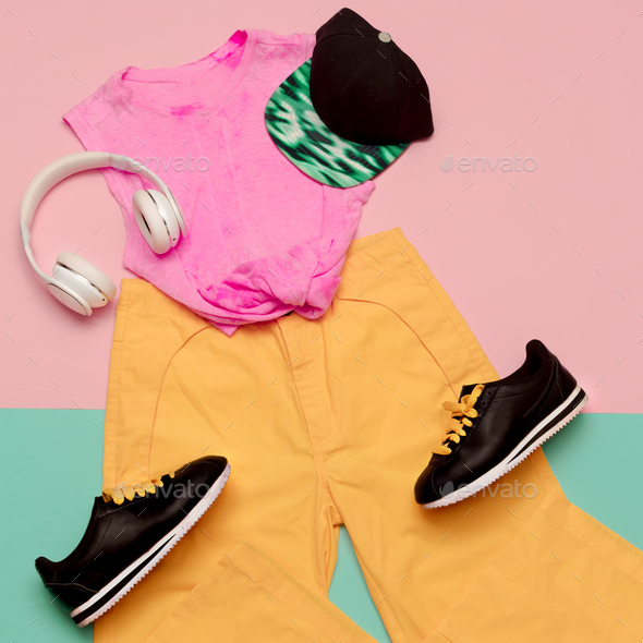 Flat lay fashion sports outfit set: shoes sneakers, trousers and - Stock Photo - Images