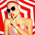 Summer secret. Blonde in beach accessories. Hot summer party - PhotoDune Item for Sale
