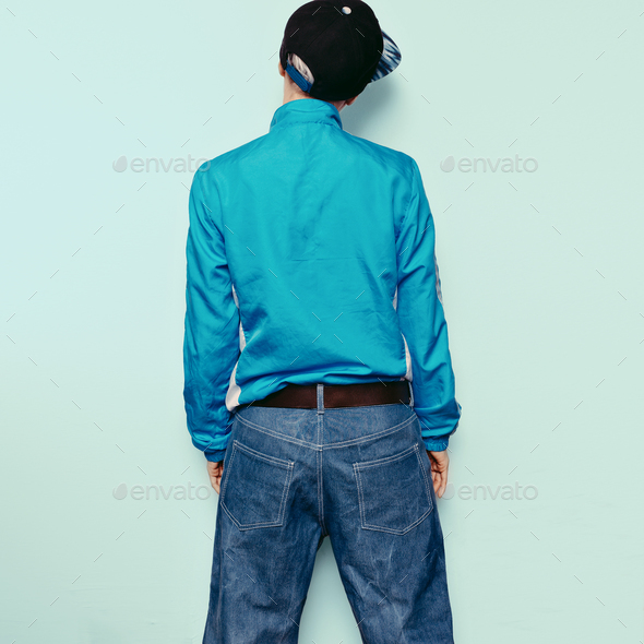 Trendy Urban Outfit Tomboy girl jeans windbreaker style cap - Stock Photo - Images