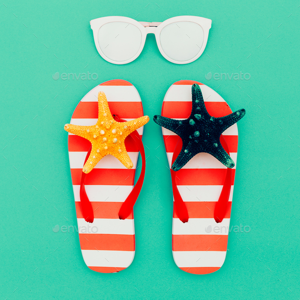 Flip-flops and sunglasses. Vacation. Summer. Minimal beach style - Stock Photo - Images