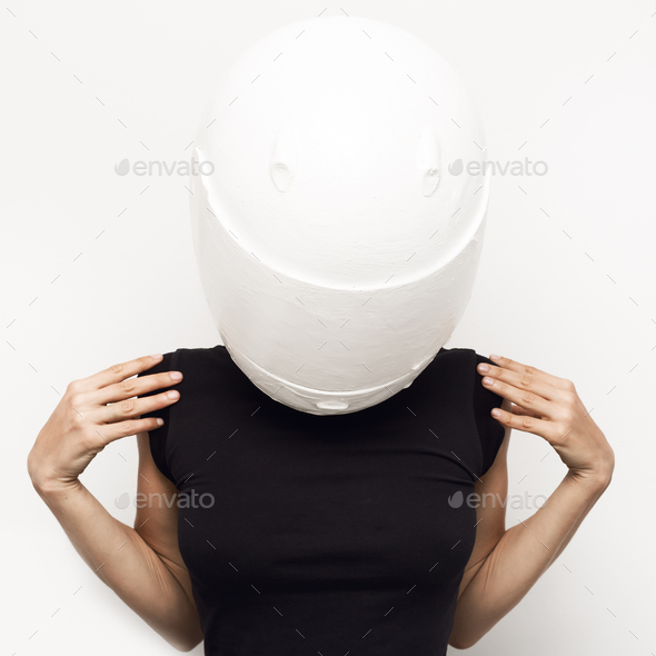 Minimal fashion art. Girl in moto helmet - Stock Photo - Images