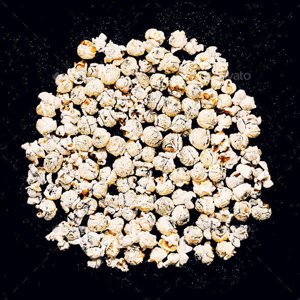 Popcorn on a black glitter background Minimal fashion - Stock Photo - Images